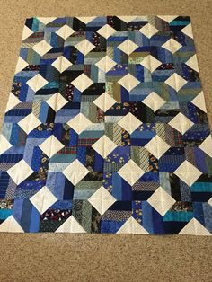 Donation quilt. Jelly roll and white sq are 3.5