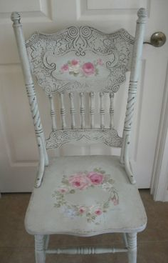 Antique pressed back chair painted with roses by Debi Coules.