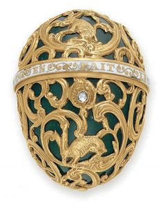"AN ANTIQUE BLOODSTONE, DIAMOND AND ENAMEL BONBONNIERE   The bloodstone egg decorated with sculpted gold rabbits and foliate detail, intersected by a white enamel band with the phrase ""l'amitie en fait le prix"", the rose-cut diamond pushpiece opening to reveal a single compartment, mounted in gold, English, nineteenth century, 1¾ x 1 3/8 ins."