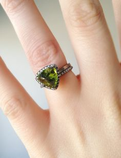 https://www.etsy.com/listing/492135014/peridot-engagement-ring-trillion-ring?ref=shop_home_active_32