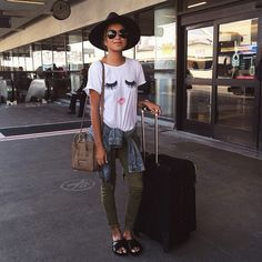 """""""Airport look wearing my @shop_sincerelyjules new favorite tee! ❤️ www.shopsincerelyjules.com"""""""