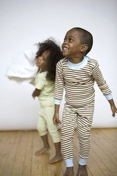 Organic pajamas in long john style. Cocoa stripes with blue trim. Sizes 9/12 mos. to youth 12.