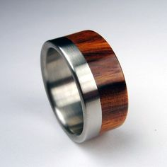 Titanium and rosewood. This Etsy shop has lots of rings with perfect detail and craftsmanship.