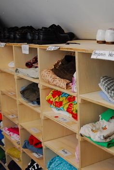 family closet - seven cubbies per kid, one outfit per cubby