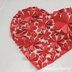Folding hearts in half then arranging to create a flower - awesome idea!