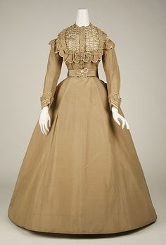 Dress #1865 #1869. Neat scallops! And buttons! And never seen the satin puffs or the the bodice front like that ever!