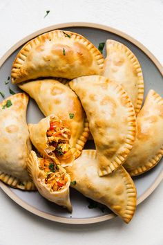 Tender juicy shredded chicken onions peppers and garlic make a hearty savory filling for our easy chicken empanada recipe. Mexican Food Recipes, New Recipes, Cooking Recipes, Favorite Recipes, Ethnic Recipes, Chicken Empanada Recipe, Chicken Recipes, Recipe Chicken, Spanish Chicken Empanadas Recipe
