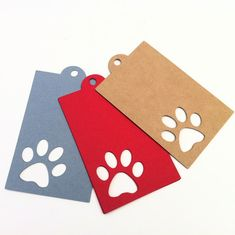 Paw print hanging gift tags, silhouette design. Red, Gray, White, Black or Kraft in natural brown with twine. Pet shop, dog, cat, gifts, pet treats, pet store merchandise tags.