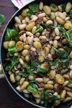A healthy vegetarian recipe for one pan gnocchi with sundried tomatoes, white beans, spinach and mushrooms! Ready in 30 minutes.