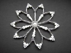 Bead star white/silver 10 cm beaded ornament by Sternenstuebchen