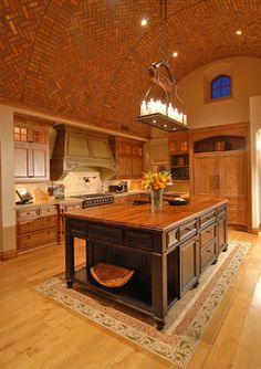 Brick barrel vault ceiling in kitchen, custom mill-work, custom wood floor with stone inlay