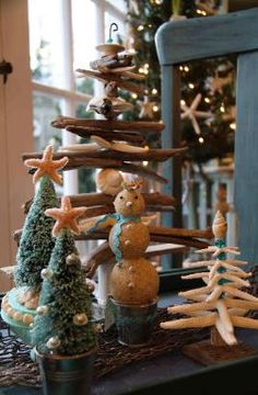 Designer Decor for a Coastal Christmas Ideas: driftwood tree, sand snowman, starfish tree, bottle-brush trees topped with star fish, etc. <> (nautical, seashore, ocean, beach, theme, Xmas, decor)
