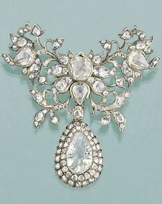 A late 18th century diamond brooch. The closed-set rose-cut diamond butterfly shaped foliate cluster suspending a later 19th century pear-cut diamond and diamond cluster drop