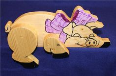 """This item is cut on the scroll saw from 3/4"""" pine wood, hand painted  and clear coated.   Item measure 5 1/2"""" tall x 10"""" long x 1 1/2"""" thick.    Made in the USA by a Veteran and his family."""
