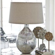 Sophisticated and graceful, the Antique Mercury Glass Sphere Lamp measures 17.5 x 17.5 x 28.5 inches of intrigue for your exceptional coastal home. This item is not returnable, except in the unlikely event of defect or damage.  Free Shipping On This Item!!