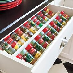 "No more knocking everything over to reach the back of the cabinet! ""Angled spice drawer makes locating the cinnamon easy as apple pie."" @ DIY Home Design"