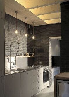 Although the dark grey brick is quite modern (and sombre?), imagine wood ceiling beams, plank wood floors and a rustic farm table. Great for a modern farm look.