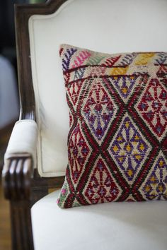 Traditional Living Room - An armchair with a patterned throw pillow
