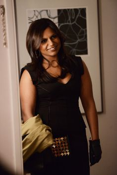 b57a517ad9de1 Mindy s black peplum dress and gold houndstooth clutch on The Mindy Project