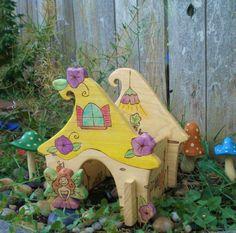 Wooden flower fairy cottage
