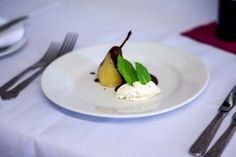 Poached pear with praline cream, spiced chocolate sauce