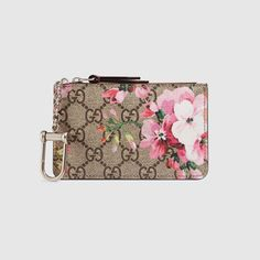 0d3690c5699db Shop the GG Blooms key case by Gucci. A special edition Blooms print on our