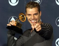 "Ricky Martin with his Grammy Award for ""Vuelve"" on February 1999 at the Shrine Auditorium in Los Angeles. Ricky Martin, Fun Shots, Beautiful Men, Cute Pictures, Hot Guys, People, This Or That Questions, Celebrities, Grammy Award"