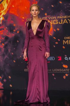 Jennifer Lawrence looked divine at the Berlin premiere of The Hunger Games: Mockingjay Part 2 in purple Dior with a low-cut neckline. Come see what her co-stars were wearing on the red carpet!