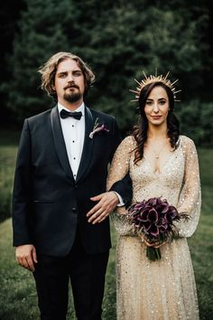 Maxine channels her inner sun goddess with a sheer, nude wedding dress accented with mesh jewels, but adds a gothic glam twist with dark purple calla lilies