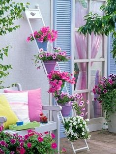Mixed Petunias in cascading painted metal plant stand