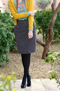 Cute polka dot skirt with mustard yellow sweater and blue shirt.