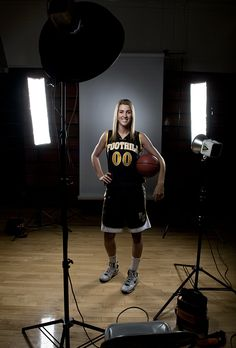 PORTRAIT: Female basketball player | The blog of Los Angeles sports portrait photographer Dustin Snipes 3 lights, 1 beauty dish in front two lights in back with strip boxes.