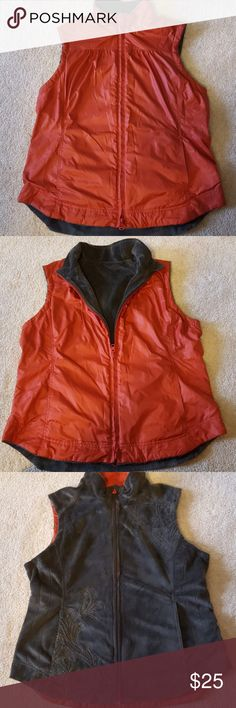 Fleece lined reversible vest Beautiful fleece lined vest.  Rust colored nylon on one side, charcoal soft fleece with embroidered pattern on the other side.  Hand pockets on both sides.  Excellent condition! REI Jackets & Coats Vests