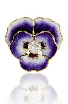 An antique enamel and diamond pansy brooch with pearl decoration. Additional swivel pendant hook, in 14k gold.