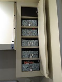 Organize cabinets/pantry by covering recycled boxes with paper or fabric, bracket from hardware store for handles (cheap) and label. Great for small items such as vitamin bottles, spices, snacks etc.