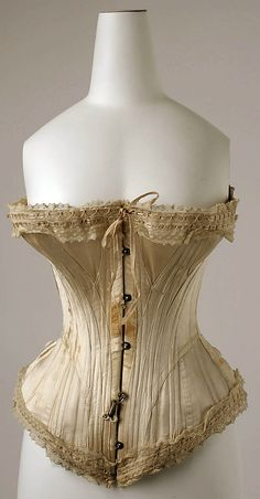 1891, French, silk, cotton, baleen. Really interesting patterning. The thin diagonal front panels leading into much Edwardian patterning I suppose, but interesting how they partially overlap the busk.
