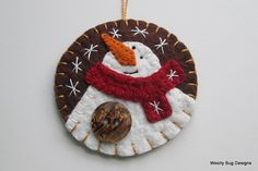White Wool Felt Snowman Ornament, Red Wool Felt Scarf, Chocolate Brown Wool Felt Background Color, Fancy Brown and Black Swirled Button