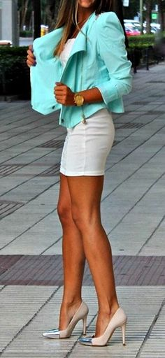 Tan skin, aqua jacket, white mini
