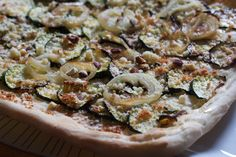An updated take on the Provencal classic: Pissaladière. Crusty, sunny squash topped by plenty of caramelized onions, cheese, and hazelnuts.