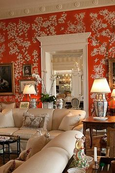 Hand - painted Chinoiserie wallpaper in orange is so dramatic and works with traditional or modern furnishings. Love this room!