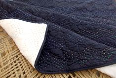 Black quilted bedspread chevron pattern zig zag quilting