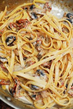 Sun dried tomato and mushroom pasta in a creamy garlic and basil sauce - Italian comfort food! JuliasAlbum.com #fettuccine #dinner