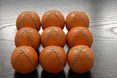 9 leather juggling balls by Emcouros in Etsy Photo by nifunifa #jugglingball #filled with #seeds #leatherart #juggling #juggler #circus #acrobat #malabares #pelota #leatherball #oneofakind #unique #soft #orange #handstitched #handmade