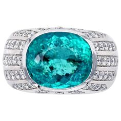 Paraiba Tourmaline Diamonds Gold Ring | From a unique collection of vintage cocktail rings at https://www.1stdibs.com/jewelry/rings/cocktail-rings/