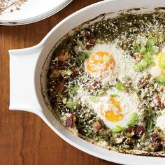 Mexican Eggs in Purgatory | For the Italian breakfast dish Eggs in Purgatory, eggs are baked in a spicy tomato sauce. In this Mexican-inspired take, Grace Parisi substitutes a vibrant, fresh green sauce made with tomatillos, cilantro and scallions.