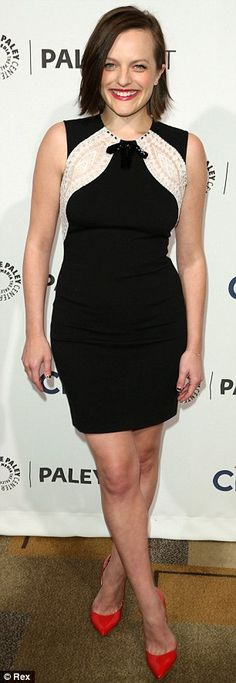 Red-y for the pictures! Elisabeth Moss punched up her black and white dress with a strawberry pout and scarlet pumps