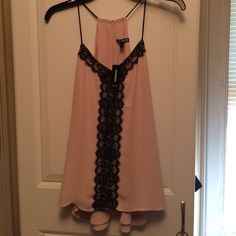 Light Pink Top with Black Lace Light pink top with black lace detail. Brand new from express. Tags are still on and has never been worn. Perfect top for going out! Express Tops Tank Tops
