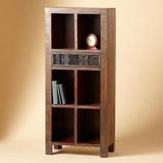 SMALL SECOND GENERATION CARVED CUBBY CABINET--Fresh new storage in a handsome cabinet crafted from recycled wood with remnants of the original paint still evident. Carved-front drawers add character, as well as storage.