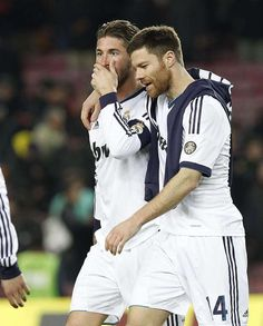 Sergio Ramos, Xabi Alonso. Sergio looks confused, wonder what kind of true stories Xabi's telling to him. :D