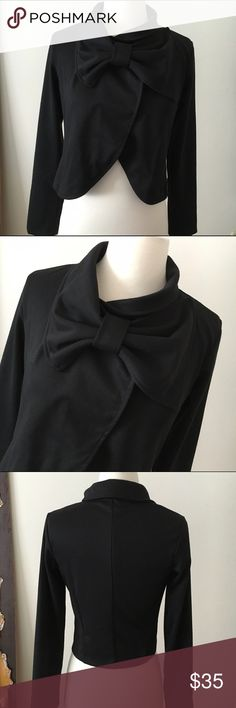 GARCIA Fantastic Little Black Jacket . City Chic GARCIA CITY CHIC A Wonderful Black Jacket with Wrap Bow Front Collar . Long Sleeves Lovely Fabric . Size Small Preloved never worn . In Excellent Condition. RePosh just didn't fit me . So sad I love it  Gracia Jackets & Coats